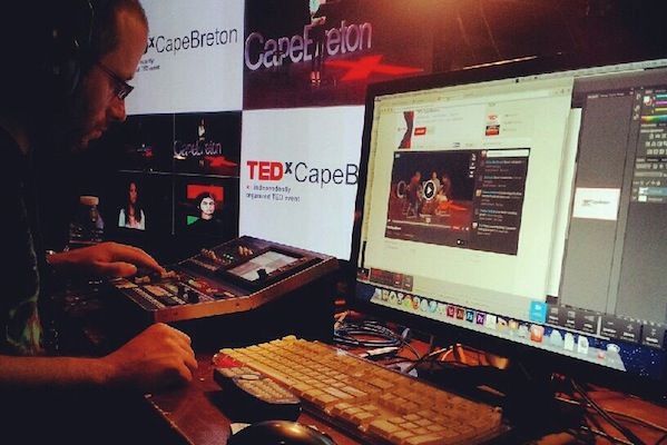 TEDxCapeBreton Production Coordinator Darcy Campbell in the control room. Campbell's new company NovaStream, formed with Scott Moore, was responsible for the live streaming of the event - photo: Scott Moore