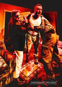 """The one-eyed Christy (Sam White) and the cat sympathetic Joey (Clayton D'Orsay) restrain the wild eyed Padraic (Steven Peters) in a tense moment from the Highland Arts Theatre's production of """"The Lieutenant of Inishmore"""". photo - ProPhotographic Cape Breton"""