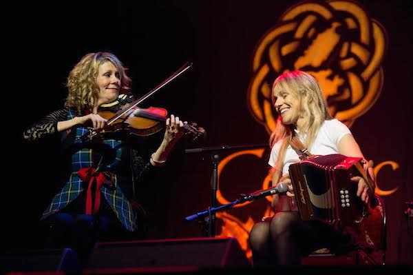 Natalie MacMaster joins Sharon Shannon onstage for a tune during the final concert of Celtic Colours 2014 - photo: Corey Katz