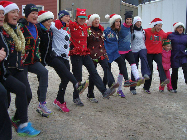 Runners break out into a song and dance at the finish line following the 2013 Ugly Sweater Run for CB children that raised about 60 gifts and $300 for 40 families in crisis - photo: Tera Camus