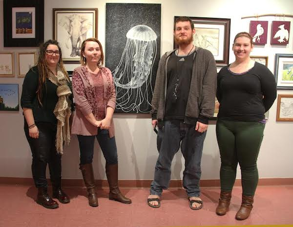 Members of the CBU Art Gallery Society Kayla Cormier, Savannah Anderson, Matthew Penney, and Kasy Benoit during installation of the CBU Art Gallery's community exhibition, ProletariART 2015: The People's Exhibit - photo: CBU