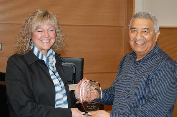 Charlie Dennis (right), Chair of the CEPI Steering Committee, presents the 2014 Bras d'Or Golden Award for a community group to Jen Rowe of Race the Cape Association.