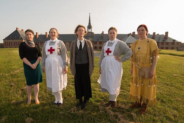 "The cast of ""Katharine's Island"" (Jenn Tubrett, Lindsay Thompson, Sandy Anthony, Kathleen O'Toole, and Maura Lea Morykot) pose in front of The King's Bastion. The play about Cape Breton philanthropist Katharine McLennan runs every Wednesday night in July and August at the Fortress of Louisbourg National Historic Site - photo: Chris Walzak"