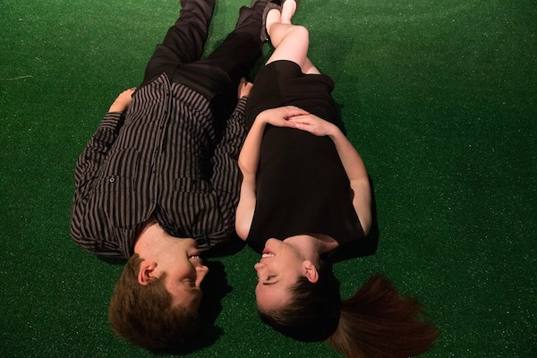 "Jonathan Lewis and Bhreagh MacNeil, as Jonathan and Caitlin upside down in love in Wesley J. Colford's ""Mature Young Adults"", directed by Anna Spencer, running Friday nights in July at The Highland Arts Theatre - photo: Chris Walzak"