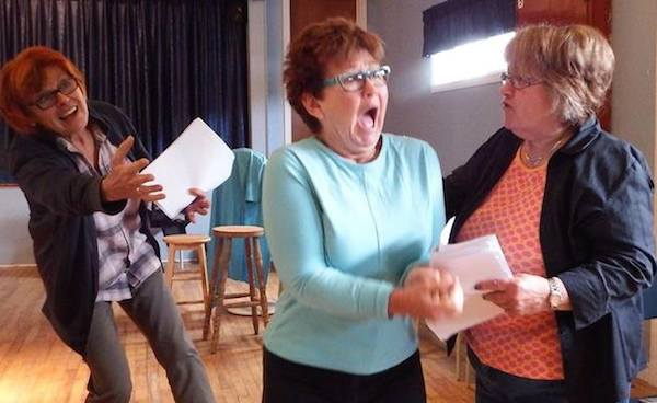 "Jitka Zgola, Yvonne LeBlanc and Nancy Smith rehearsing a scene from an adaptation of Lyn Coady's short story ""Jesus Christ Murdena"""