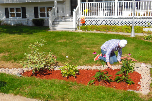 Sarah Penney, ACAP Project Coordinator, installing a rain garden to help a homeowner manage stormwater on her property.
