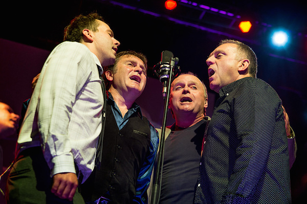 "Boyd, Stewart, Kyle and Sheumas of the Barra MacNeils singing Stewart's song ""The Underachiever"" during the Celtic Colours closing concert Ricky's Rattlin' Roarin' Roots at Centre 200 in Sydney. - photo: Corey Katz"