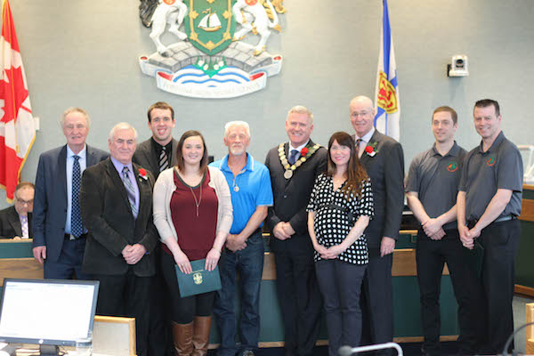 (L-R) Councilor Lowell Cormier, Councilor Kevin Saccary, Cyril MacDonald, Sarah Goode (accepting on behalf of her sister), Bill Smith, Mayor Cecil Clarke, Alexis McDonald Lamarche, Councilor Ray Paruch, Steve Fifield (Basketball Cape Breton), Greg Callahan (Basketball Cape Breton)