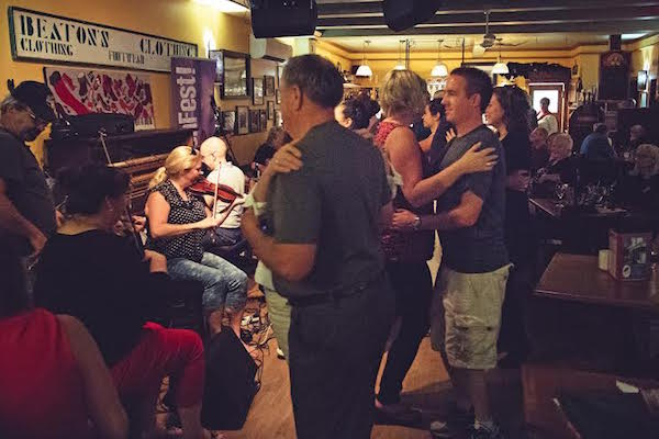 Red Shoe Pub-goers dance to Shelly Campbell, Andrea Beaton and Joel Chiasson during Kitchenfest! last year. The third annual Kitchenfest! kicks off a week of music, food and cultural events on July 2.