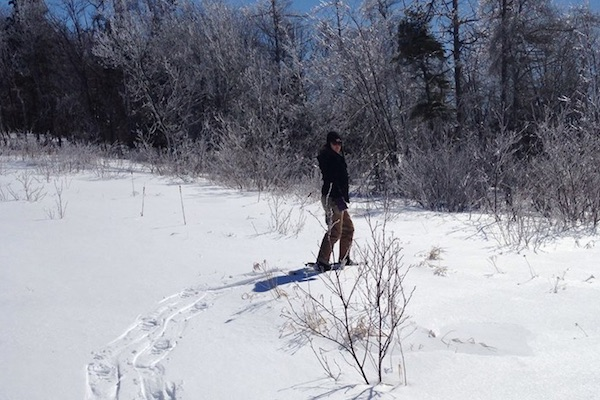 Jen Cooper, ACAP Project Coordinator, at Waterford Lake in 2015 checking out the trail for that year's annual Watershed Snowshoe Walk. This year's snow shoe hike is scheduled for February 12 at Pottle Lake in North Sydney - photo: Ashley Shelton