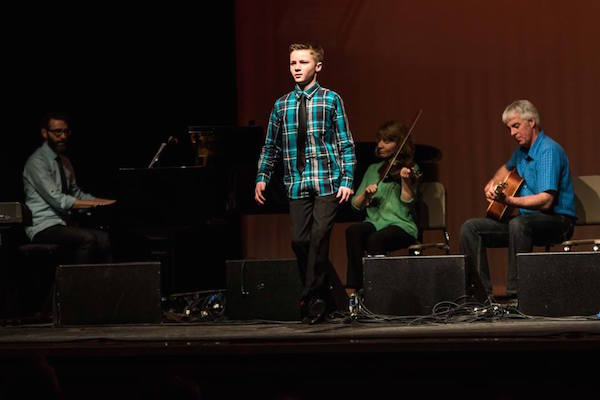 Stephen MacLennan dancing with Mac Morin on piano, Melody Cameron on fiddle and Derrick Cameron on guitar during last year's Old Fashioned Scottish Super Concert at Strathspey Performing Arts Centre - photo: Steve Rankin
