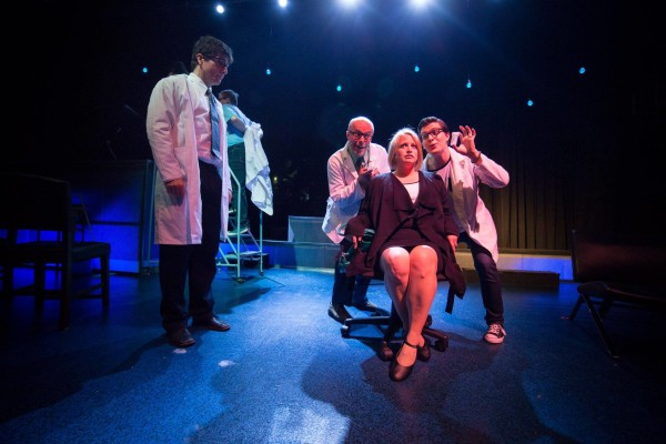 "Heather Merrill, as Diana, faces the prospect of drug therapy offered by her psychiatrist, played by Ron Newcombe, and his associates (Marty Burt, left, and Brandon Carabin, right) in the Highland Arts Theatre's production of ""next to normal"" onstage until Wednesday, May 24 - photo: Chris Walzak"