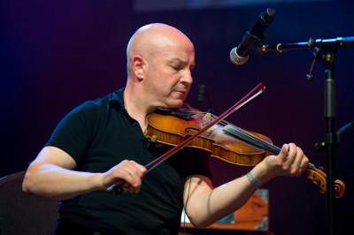 Versatile Scottish musician John McCusker appears  on two tracks, in a trio with Michael McGoldrick and John Doyle, and backing Dwayne Côté with McGoldrick, Doyle and Phil Cunningham - photo: Corey Katz
